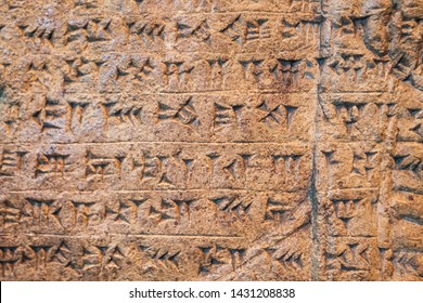 Ancient Assyrian and Sumerian cuneiform writing carving on stone from Mesopotamia .