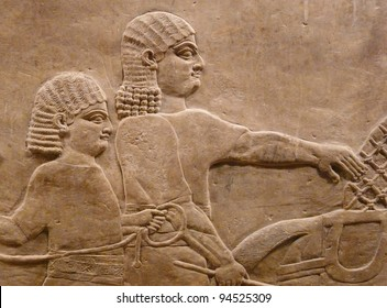 Ancient Assyrian wall carving of two men