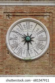 Ancient astronomical clock on the square Piazza tre Martiri in Rimini, Italy