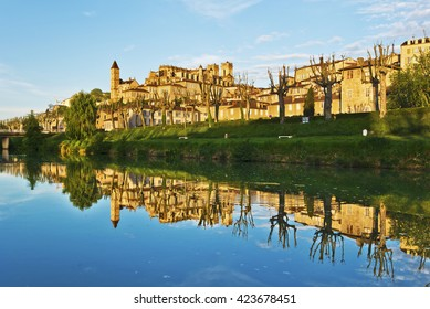Ancient Auch cityscape with Armagnac tower and Saint Marie Cathedral, reflecting in Gers River, its historical capital of Gascony,  France, midi Pyrenees