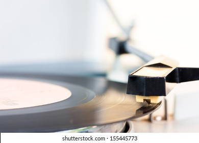 ancient audio disc while playing focus on a phonograph needle