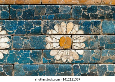 ancient Babylonian glazed brick wall with white flower decoration