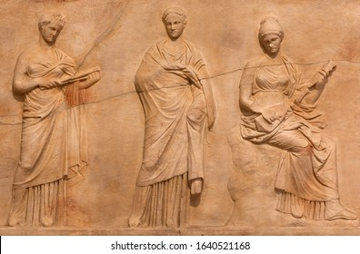 Ancient bas-relief depicting Delian chief triad of Leto (mother), Artemis (daughter) and Apollo (son) on ancient Greek funerary stele. Mantineia, Arcadia, Greece