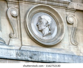 Ancient bas-reliefs on the Windows. Medallions of scientists on of National Museum of Natural History. naturalist Lamarck - creator of evolutionary theory of Lamarckism. Paris