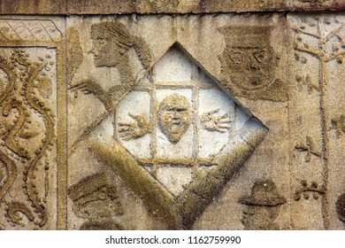 Ancient bas-reliefs on the Windows and walls of historical buildings. Architectural design elements from the past. Prison and prisoner behind bars. Sankt Christophorus Autobahnkirche Baden-Baden
