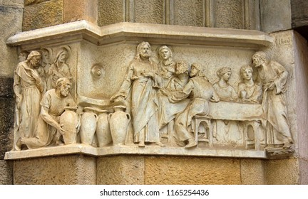 Ancient bas-reliefs on the Windows and walls of historical buildings. Architectural design elements from the past. The biblical parable of the feast in Cana of Galilee. Barselona