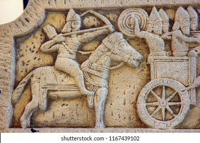 Ancient bas-reliefs on the Windows and walls of historical buildings. Architectural design elements from the past. The Assyrian warriors. Leoret de Mar
