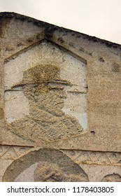 Ancient bas-reliefs on the Windows and walls of historical buildings. Architectural design elements from the past. imposing man in a hat. Sankt Christophorus Autobahnkirche Baden-Baden