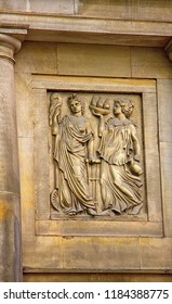 Ancient bas-reliefs on the Windows and walls of historical buildings. Architectural design elements from the past. Warsawa. Maids