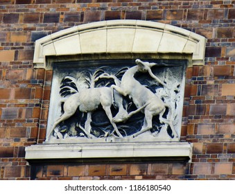 Ancient bas-reliefs on the Windows and walls of historical buildings. Architectural design elements from the past. Fighting male antelope. Paris