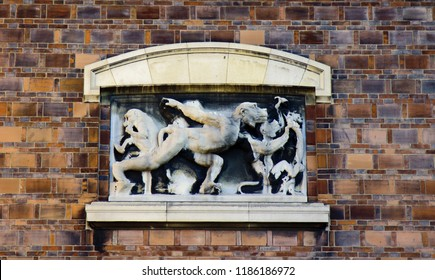 Ancient bas-reliefs on the Windows and walls of historical buildings. Architectural design elements from the past. Paris. Inspired by a monkey, a satire on human