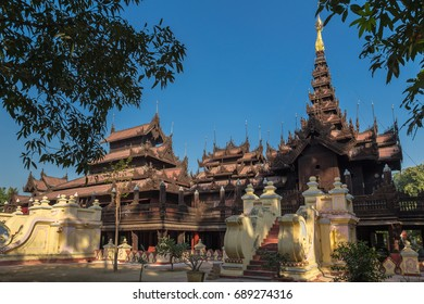 Ancient beautiful Buddhist monastery Shwe In Bin Kyaung carved from teak wood in Mandalay, Myanmar