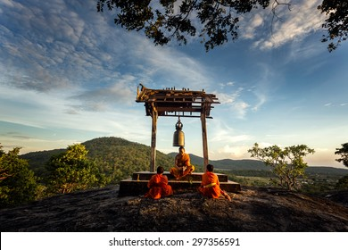 Ancient bell  and monk was teaching Novice at sunset in Saraburi, Thailand