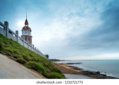 The ancient bell tower located on the coastline, Haikou, Hainan, China.