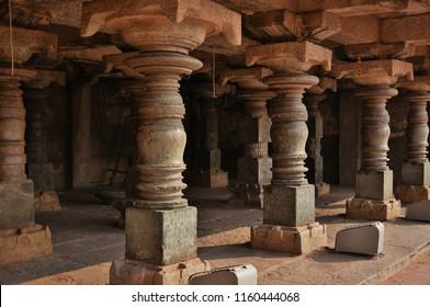 """Ancient Black stone pillars of a double storied hall near Virupaksha temple complex, Hampi, Karnataka"""