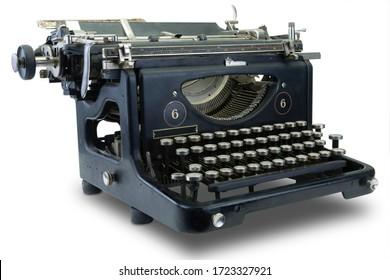 Ancient black typewriter isolated on white