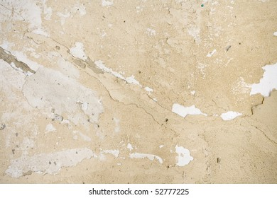 Ancient blistered mediterranean creme wall