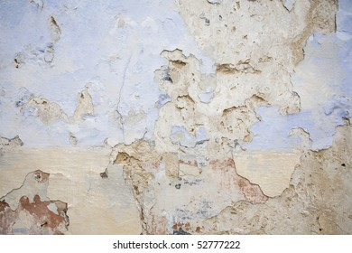 Ancient blistered mediterranean wall