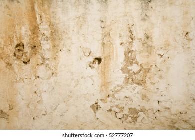 Ancient blistered mediterranean yellow orange wall