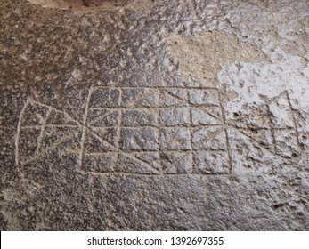 Ancient board game carved on to the stone floor of Ellora caves