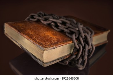 Ancient book chained closed symbolizing, hidden secret and occult knowledge