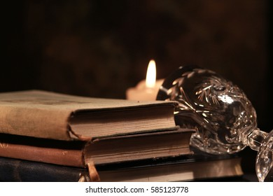 ancient books and candles
