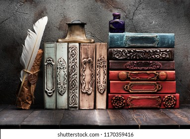 Ancient books, manuscript with a wax seal on the shelf, ink in a bottle and bronze inkwell with a feather
