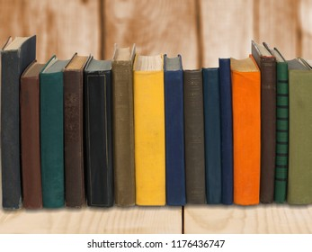 Ancient books in a row on wooden