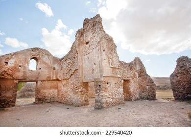 Ancient brick walls of crumbling buildings in the Middle East