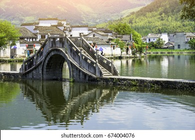 Ancient bridge in charming old village of Hongcun. Hongcun village scenery in Huangshan, Anhui, China.It is located near Huangshan.Hongcun is a famous historical village in China, UNESCO heritage site
