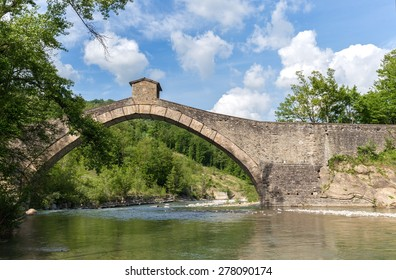 ancient bridge on the mountain river
