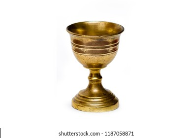 Ancient bronze chalice isolated in white background