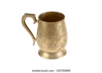 Ancient bronze mug with a flower ornament