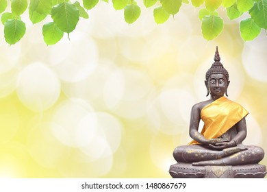 Ancient buddha statue and bo leaf  background, Thailand holiday wallpaper.