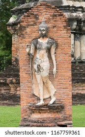 Ancient Buddha Statue in front of pagoda of the Buddhist temple at Sukhothai Historical Park,UNESCO World Heritage.