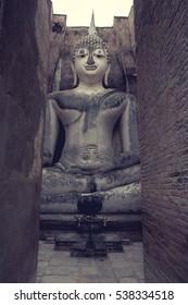 Ancient buddha statue. Historic Town of Sukhothai and Associated Historic Towns, Sukhothai Historical Park, Wat Si Chum, Sukhothai, Thailand,  process color.