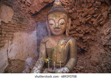 Ancient Buddha statue inside the ruined temple in Indein, Inle lake area, Myanmar
