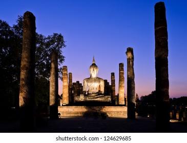 Ancient buddha statue at twilight, Wat Mahathat in Sukhothai His