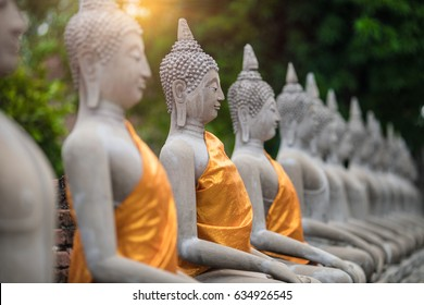 Ancient Buddha Statue at WAT YAI CHAI MONGKOL, The Historic City of Ayutthaya, Thailand,/select focus point.