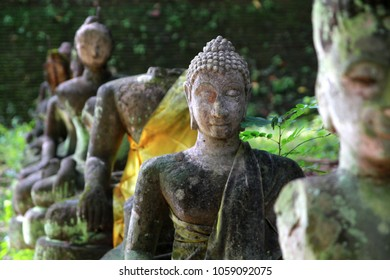 Ancient buddha statues covered with moss in old temples the historical site landmarks in Chiang Mai Thailand