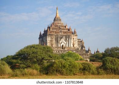 Ancient Buddhist temple of Thatbyinnyu Phaya in the sunny day. Bagan, Myanmar (Burma)