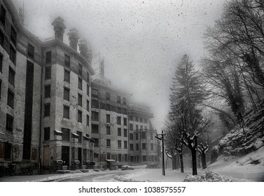 ancient building abandoned under a heavy snowfall in a winter morning