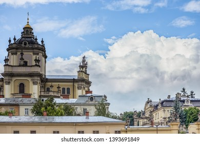 Ancient building behind arch. Old arch, church in Lviv, Ukraine. Archicatedral Cathedral of Saint Jura