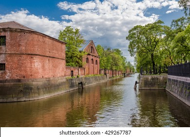 Ancient building of purveyance warehouse of Admiralty in Kronstadt on the banks of the Bypass channel, Russia