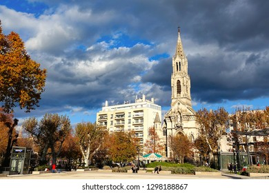 ancient building and tower with cloudy sky in Nimes, France.