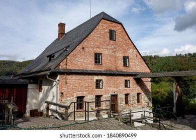 The ancient building of Wesselsky water mill built from red bricks in 16th century - Shutterstock ID 1840890499