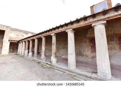 Ancient Buildings with Roman Pillars in Pompeii, Italy