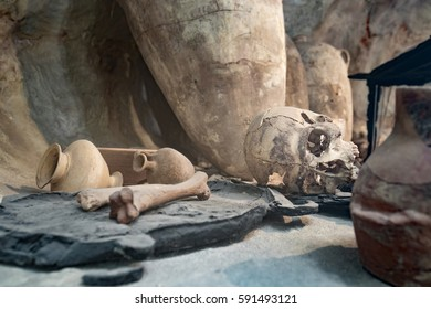 Ancient burial site with a skull and pottery from another milenium