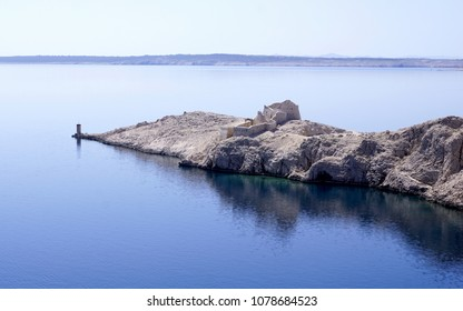Ancient Byzantine old town of Fortica, ruins on the edge of the Island of Pag, touristic destination in Dalmatia, Croatia h a turquoise blue reflection in the sea surface