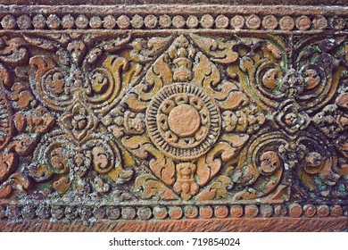 Ancient Cambodian Stone carving on wall of temple complex set in Phanom Rung Historical Park, Buriram province, Thailand